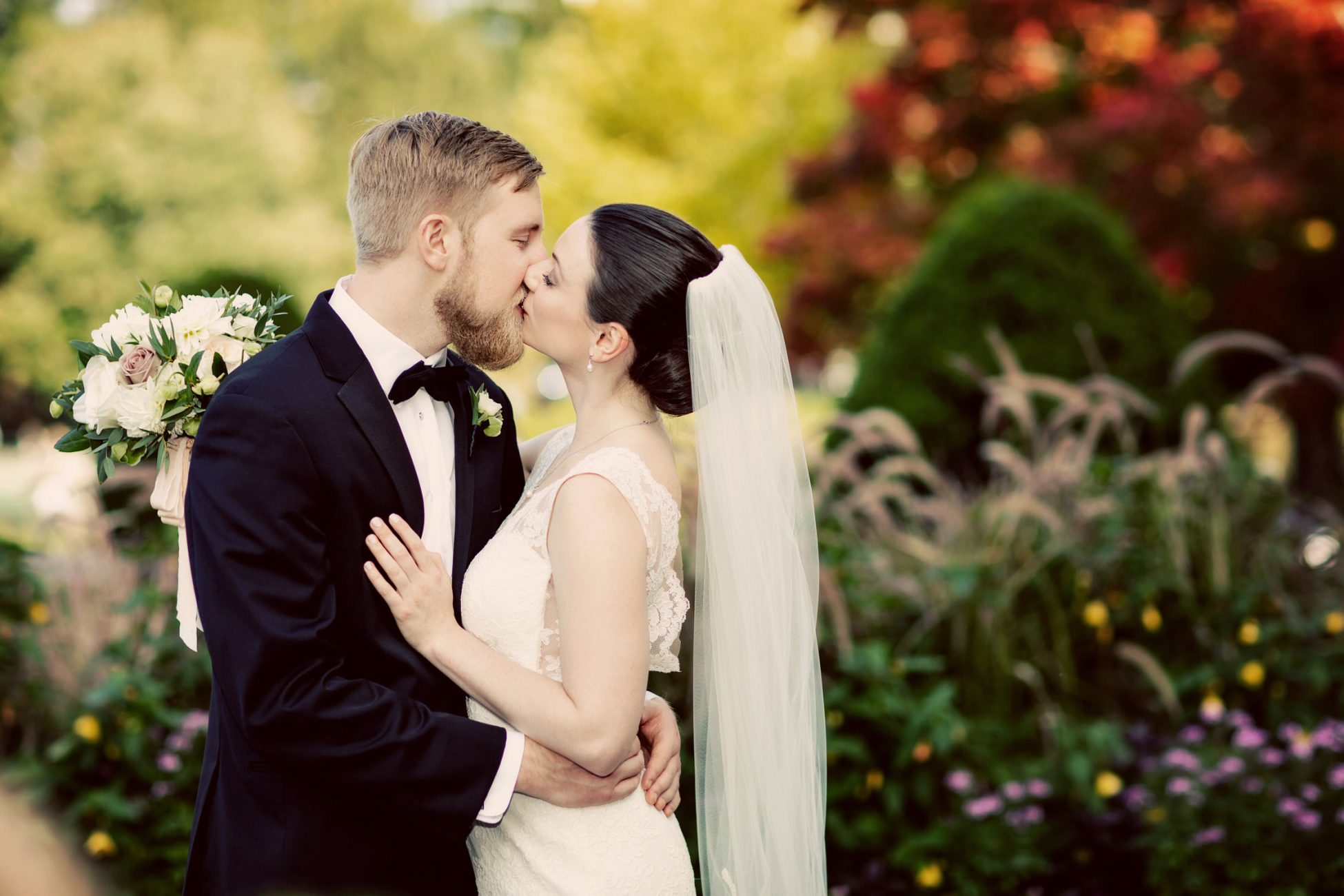 Photograph of Couple Kissing at their Wedding